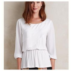 "NWT Anthropologie Deletta White Ruffle Blouse Sz L NWT Anthropologie Deletta White Ruffle Blouse --- Sz L --- rayon / spandex  95/5 blend --- body of shirt is rayon/spandex, ruffle and sleeves are polyester --- ruffled front and elastic nipped waist --- pullover styling --- machine washable --- 23"" bust --- 27"" length --- thank you for visiting my boutique, please feel free to ask any questions Anthropologie Tops"