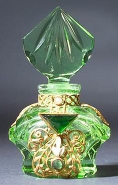 A Czechoslovakian mini perfume bottle, circa 1920s, in green crystal, with enameled and jeweled metal filigree