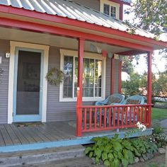 Galvanized metal roof over porch area.  Oooh I like.