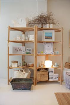 Portable shelving with screen and shelf: this would be great for a craft booth!