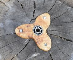 How to make a Handcrafted Fidget Spinner! This is a super easy project, and perfect for fidgety hands! If you're not aware of what these are, they're basically a toy for when you have nothing to do; and all you have is a toy to Fidget with!So without further ado; let's get started!Materials/ Tools:• Burl (or any type of wood)• Pencil• Drill• Spade bit (3/4 in.)• Drill bit (1/4 in.)• Vise• Nail/ Bolt...