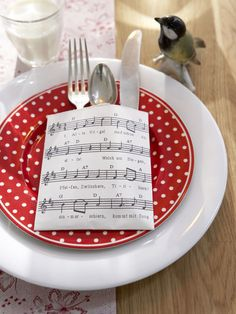 Love the music holding the silverware.  Add some pine and jingle bells, cute christmas setting!