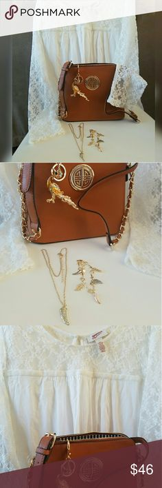 Gift set: Blouse, Handbag, Keychain and Jewelry A $60 VALUE!!  White and gold gift set includes: ♢Comfortable white blouse with lace sleeve, a host pick ♢Faux leather tan crossbody with gold zipper. Measures 9 inches wide and 8 inches tall with an adjustable strap of 20 inches. ♢Peacock key chain in gold and white rhinestones ♢Bracelet with 5 hanging charms tigertooth and leaves in 3 colors, Tigertooth necklace with white rhinestones brings good luck Accessories