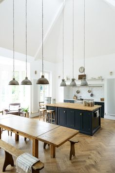 This lovely big kitchen in Kent mixes vintage pendant lights, original parquet flooring and beautiful deVOL Shaker cabinets in Pantry Blue