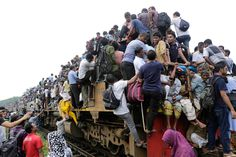 Today In Pictures: September 24 - NBC News 7. Homebound people overcrowd a train in an attempt to travel to their villages, ahead of the Eid Al-Adha celebrations, at the Airport Railway Station in Dhaka, Bangladesh on September 24. Millions of Muslims travel back to their villages to celebrate the big festival Eid Al-Adha, the Feast of the Sacrifice. Abir Abdullah / EPA