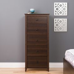 Tall and slim, this 5 drawer chest will add a modern and sleek look to any room. With 5 large drawers, this is sure to be the solution to all of your storing needs without looking out of place.