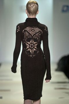 I want to make one of these, it's the main reason I'm learning to crochet! I'm thinking a low scoop-backed dress with an interesting lace pattern across the bare part of the back :)