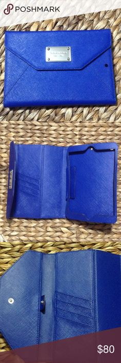 💯⚜MICHAEL KORS IPAD MINI CASE & WALLET Royal blue brand new leather iPad  mini case with built in wallet.  Silver hardware. Money holder and 4 slot credit card holder.  Velcro closure to secure iPad.  Case still stiff due to not ever being used.  Priced accordingly. Michael Kors Accessories Tablet Cases