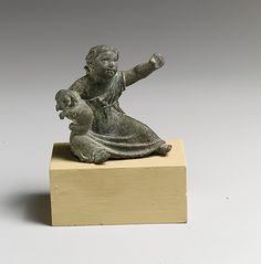 Bronze statuette of a girl holding a dog  Period: Late Hellenistic or Imperial Date: 1st century B.C.-2nd century A.D. Culture: Greek or Roman Medium: Bronze Dimensions: H. 2 3/8 in. (6 cm)