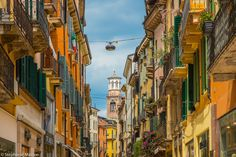 Verona by Stéphanie Masson on 500px - A colorful street in Verona, Italy.