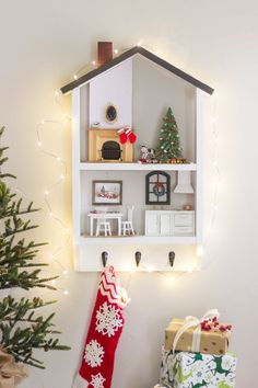How to make a DIY Holiday Dollhouse Shelf from a couple boards. Great gift idea that can be used year-long! Register for free DIY Workshop at Home Depot.