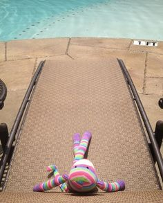 Pier 1 Rainbow Sock Monkey lays out in the sun to work on his tan