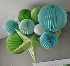 lime green aqua blue and white paper lantern baby boy nursery ceiling decoration mobile modern (Love this idea for my little girl's room, but in pink or purple. Maybe a few colors to match my quilt?)