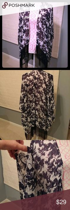 Dress up or dress down shawl New never worn super versatile. 100% poly - hand wash. Longest lengh with fringe is 40 inches. Tops