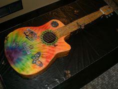 a tye-dye, hippie, guitar cake
