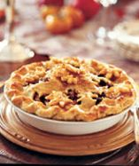 Mincemeat and Granny Smith apples make this pie as delightfully golden as the childhood memories we associate with it. To save time, use store-bought dough to speed preparation.