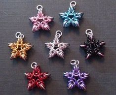 Love these chainmaille starbursts....they could be earrings, a pendant, christmas ornaments, key chains! Versatile! by wanting