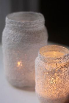 Votives might also look decorative if lace were used on the outside of the jars.  DIY Salt Jar Votives with Mod Podge by plaidkidscrafts #DIY #Mason_Jar #Luminaries we can tie cute ribbons and feathers to them!!!