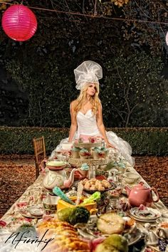 Alice in Wonderland wedding. Love the table set up. But the bride....well....ahahaha...