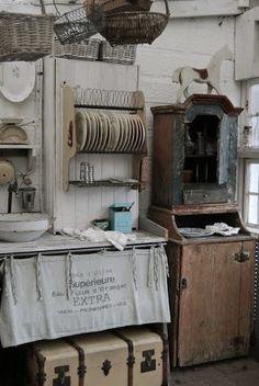 Baskets, plate rack, cupboard.    via Dreams Gather Here