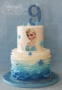 it's really hard to do something original for the Frozen theme. Fondant ruffles and sparkly snowflakes, made this cake simple and effective. :-) # frozen birthday cake Frozen Cake Ideas - In The Playroom Bolo Frozen, Torte Frozen, Elsa Torte, Frozen Theme Cake, Disney Frozen Cake, Disney Cakes, Frozen Birthday Party, Birthday Parties, 4th Birthday