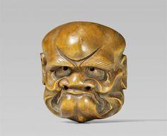 A light boxwood mask netsuke, by Akimasa (Meishô). Late 19th century, Auktion 1092 Asiatische Kunst I Indien, Südostasien und Japan, Lot 675