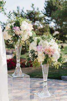 Tall blush centerpiece, ceremony flowers. Clear acrylic pedestal. Dahlias, peonies, greenery, hydrangea. Bella Collina Golf Club, Florals by Jenny. Jana Williams Photography. Me Weddings and Events