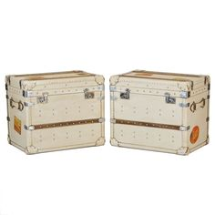 Pair of English White Leather Trunks  England  1940s  Handsome pair of circa 1930s - 1940s creamy white leather covered travel trunks from England. Embellished with travel stickers, wood and metal hardware. These trunks make great end tables.