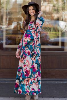 Feel comfortable in this sleek and flattering floral print sash tie maxi dress. The textured print flatters any silhouette and will transition to with you through the stages of motherhood.