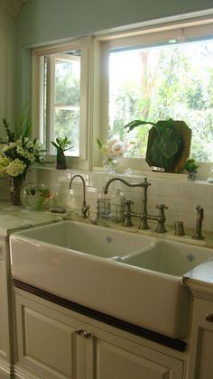 I love an apron front sink.  And that faucet, and the subway tile, and the big window...