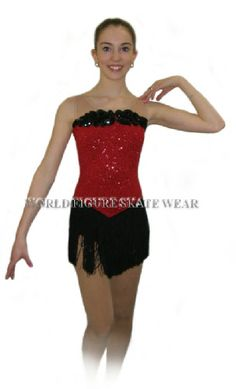 Black sequin applique finish the the front neckline which is held in place with stretch net that continues into back straps to hold the dress secure. Description from worldfigureskatewear.com. I searched for this on bing.com/images
