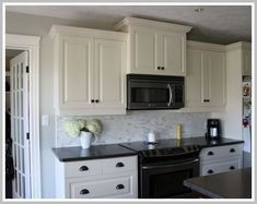 Backsplash ideas with white cabinets and dark countertops great ideas odd white cabinets with dark my kitchen counters drawer pulls and for kitchens Dark Countertops, Kitchen Cabinets Light Wood, White Kitchen Decor, White Backsplash, White Kitchen Wood Floors, Backsplash For White Cabinets, Wood Floor Kitchen, Black Countertops, Kitchen Design