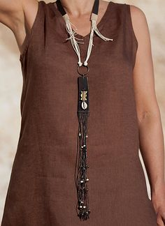 Upcycled vintage leather pendant with ethnic beads. Almathe Collection