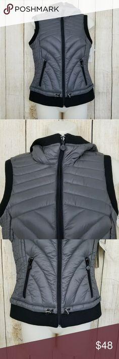 """Down vest Bernardo hooded down vest. Full zip closure, two zip pockets, packable. Size PXS. Charcoal and black. New with tags. 90% down, 10% fillers.  Measurements: armpit to armpit 17"""", length 22"""" Jackets & Coats Vests"""