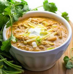 It's easy to cook a big pot of this award winning white chicken chili, and it's the absolute BEST! Tender chicken, chilies, white beans, spices and a few more goodies in this winning white chicken chili recipe! Top with sour cream, cheese, scallions, a drizzle of your favorite hot sauce. It's makes a lot of chili, but it freezes really well!