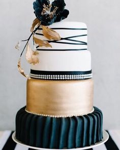 teal, gold and white wedding cake