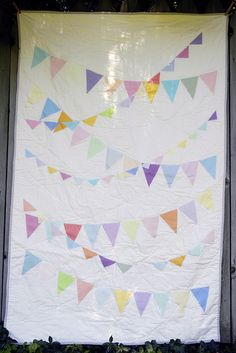 pennant banner quilt, would love to do this using fabric from their clothes and baby blankets.