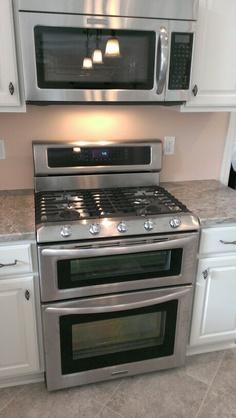 Tiny U Shaped Cottage Kitchen Features A Kitchenaid Stove