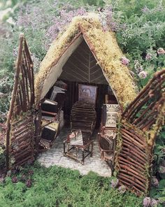 small fairy cottage with moss roof and wood doors and furniture, dreamy