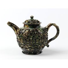 Teapot and cover, Staffordshire, England. Lead glazed earthenware 1750-60