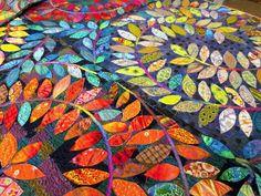 colorful, scrappy appliqued vines quilt