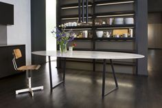 Dritto Dining Table, designed by Piero Lissoni exclusively for Salvatori, Dritto combines elegant lines of classic natural stone with a bold geometric frame crafted from iron. Its defining characteristic is the curved underside of the top, and  its uber-fine edges of a mere 5 mm which give the impression of a lightness and delicacy rarely associated with stone. Available in both honed and Lithoverde versions of the following stones: Bianco Carrara, Gris du Marais and Pietra d'Avola.