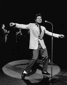 Cliff Richard - Britain's biggest music star, pre-Beatles. Initially a skiffle performer, he moved into Elvis style rock & roll in 1957 and had a string of big hits with his band, the Shadows, through the mid-'60s. Later, his music evolved into pop and Christian genres. In total, he released over 100 albums and had at least one hit per decade into the new millennium.