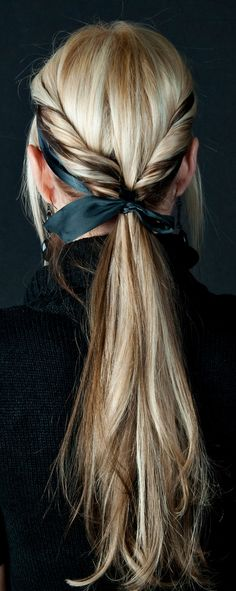 twist hair on both sides, tie both ends into a low ponytail with a ribbon