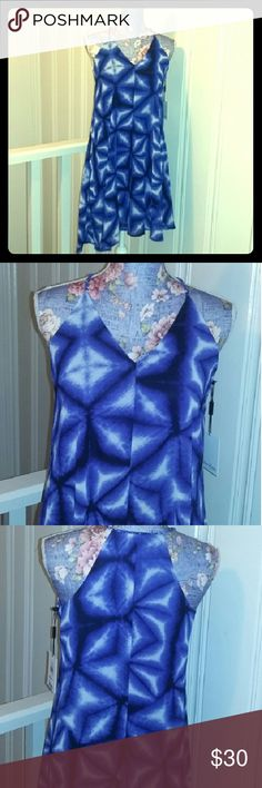 **SPRING SALE CALVIN KLEIN NWT** Absolutely adorable dress in a size 2 buy Calvin Klein. The material is 100% polyester and it does have a liner underneath. The design is a starfish abstract looking design LOL. The colors are electric blue black and white. The neckline is a basic V the shoulder straps are braided material and it goes into a racerback style. The hemline is asymmetrical. This dress is new with tags pristine condition no defects. Thank you for looking Calvin Klein Dresses…