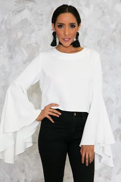 Be 'that girl' and drop jaws in our erogenous Evelyn Bell-Sleeve Top in white. Featuring an oversize ruffle bell sleeve, luxurious semi-stretch fabric, crew neckline and hidden side zipper closure. Pa