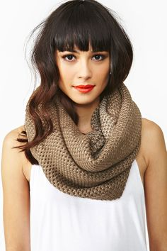 Chunky knit infinity scarf featuring a taupe and brown weave. Looks amazing with a chiffon tank and skinnies!