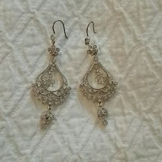 Silver toned earrings with crystal detail Silver toned chandelier earrings with crystal detail. Worn once. Jewelry Earrings