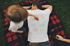 Car-track tee: Dad gets a massage while the kids play