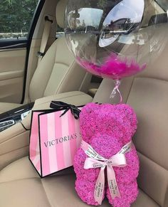 Bear made of pink roses with a ballon and Victoria's Secret gift.